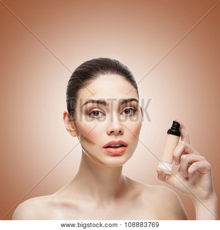 Beautiful girl with foundation container