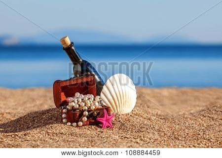 Decorative Chest With Jewelry,bottle And Starfish On A Beach
