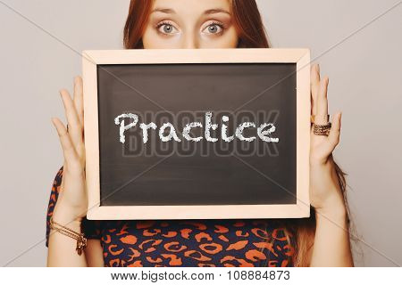 Young Woman Holding A Chalkboard Saying Practice