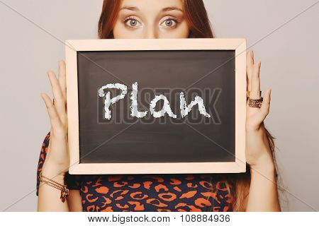Young Woman Holding A Chalkboard Saying Plan