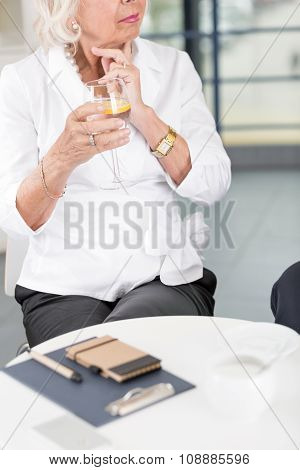 Elderly Businesswoman On A Meeting