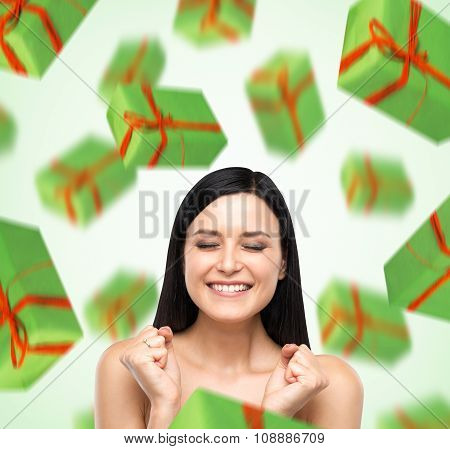 A Portrait Of Dreaming Woman With Closed Eyes Who Is Imagining Green Gift Boxes. Light Green Backgro
