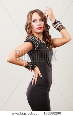 Woman With Jewellery In Black Evening Dress