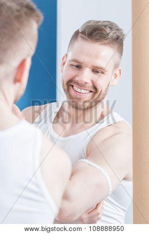 Attractive Bodybuilder Measuring His Biceps