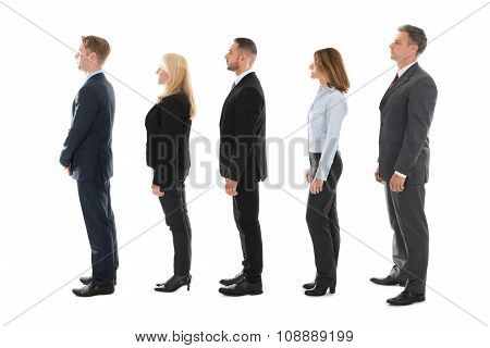 Side View Of Business People Standing In Row