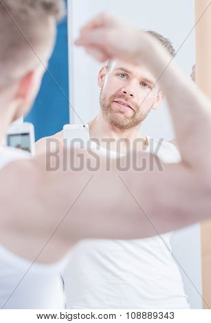 Man With Muscular Biceps