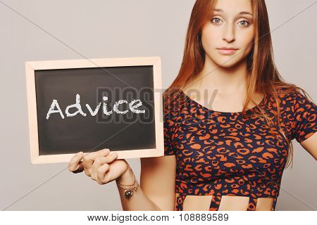 Young Woman Holding A Chalkboard Saying Advice.
