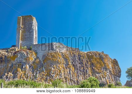 The ruins of the tower of a medieval castle on a rock