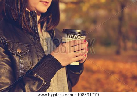 Hipster Girl Holding Coffee Cup