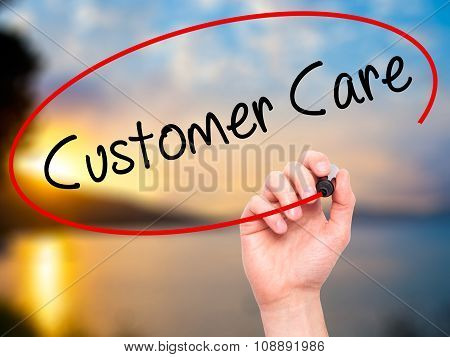 Man Hand writing Customer Care with marker on visual screen.