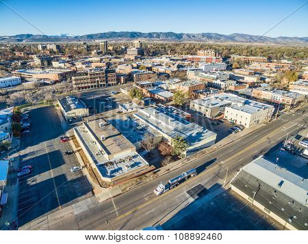 FORT COLLINS, CO, USA - NOVEMBER 15, 2015: Aerial view of Fort Collins downtown,  fall  scenery with Front Range of Rocky Mountains in background