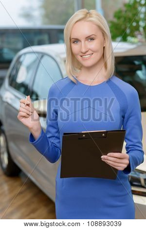 Attractive woman holding a clipboard