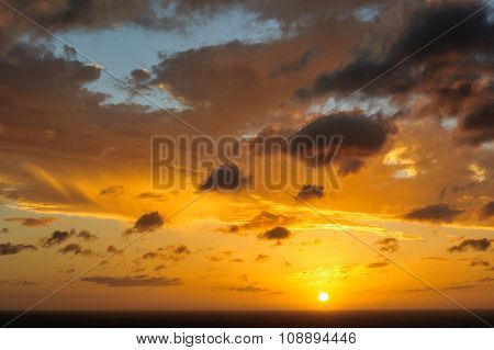 Sunset with many clouds