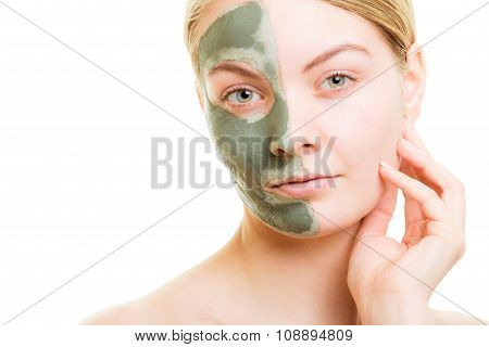 Woman In Clay Mud Mask On Face Isolated On White.
