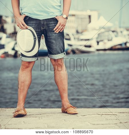 Closeup Of Man Legs On Pier In Port With Yachts.