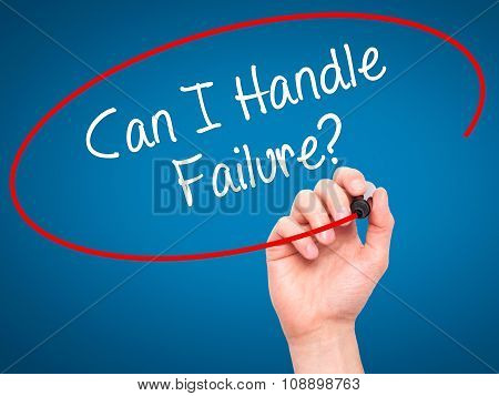 Man Hand writing Can I Handle Failure? with black marker on visual screen.