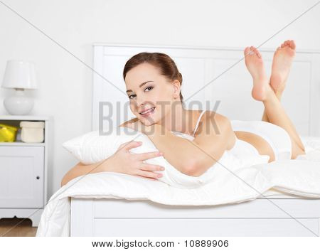 Happy Beautiful Woman Relaxing Lying On Bed