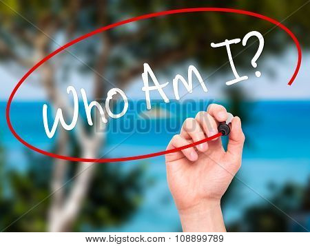 Man Hand writing Who Am I? with black marker on visual screen.