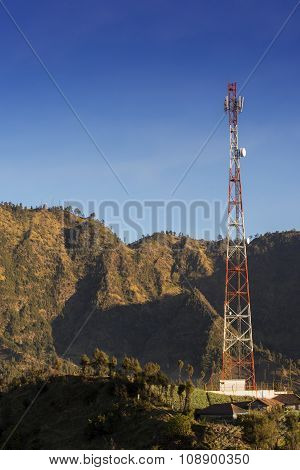 Telecommunications tower at sunrise and blue sky.