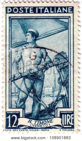 Italy - Circa 1950: A Stamp Printed In The Italy Shows Sailor Steering Boat, Veneto, Circa 1950