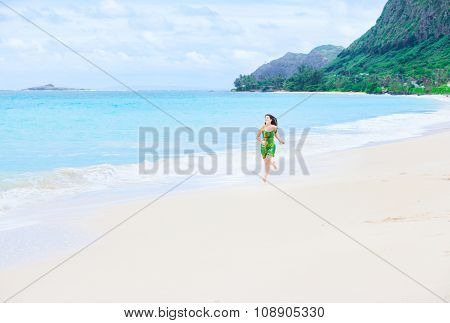 Beautiful Teen Girl In Green Dress Running On Hawaiian Beach