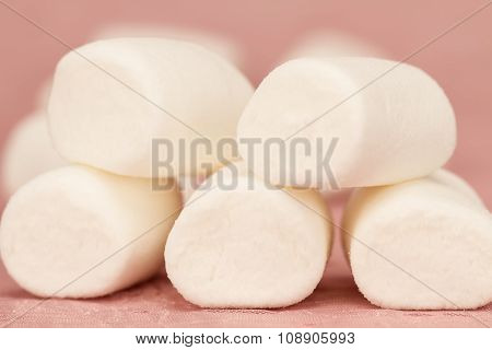 Sweet Marshmallows On A Pink Background