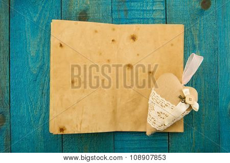 Vintage Heart And An Old Blank Book On A Blue Wooden Background