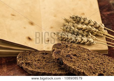 Wheat On Wooden Table With Bread With Cranberries. Thanksgiving
