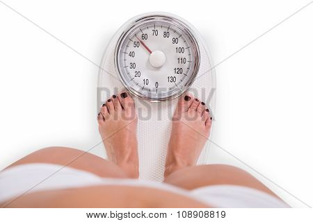 Young Woman Checking Weight Over White Background