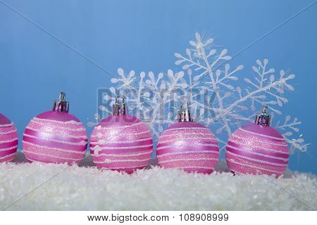 Pink Balls And Snowflakes On The Snow