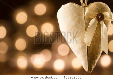 Vintage Heart On Yellow Background Defocused Lights. Festive Decoration. Christmas