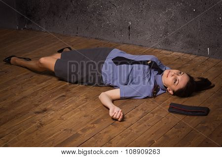 Woman Police Officer Lying On A Floor