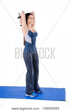Young woman shows starting position of Standing Triceps Extension Dumbbell behind head workout, isolated on white