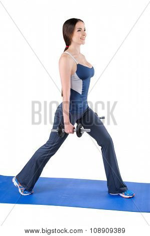 Young woman shows starting position of Dumbbell Split-Squat workout, isolated on white