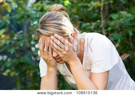 Woman Covering Face With Hands