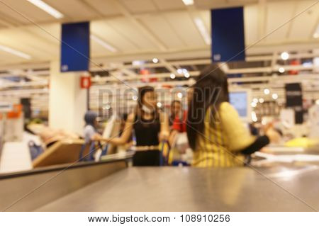 Blurred Cashier In Supermarket