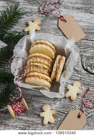 Cookies With Caramel Cream And Walnuts In A Vintage Metal Box  And  Christmas Decoration  On Bright