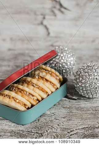 Homemade Cookies In Vintage Box And Christmas Decorations On A Light Wooden Surface