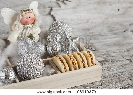 Shortbread Biscuits With Caramel Cream And Walnuts, Christmas Decorations And Christmas Angel In A W