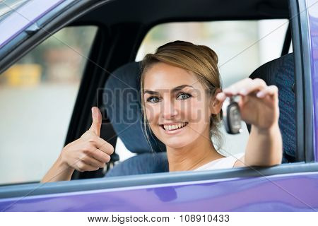 Woman Gesturing Thumbs Up While Holding Car Key