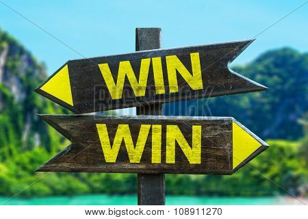 Win Win signpost in a beach background