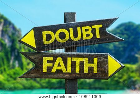 Doubt - Faith signpost in a beach background