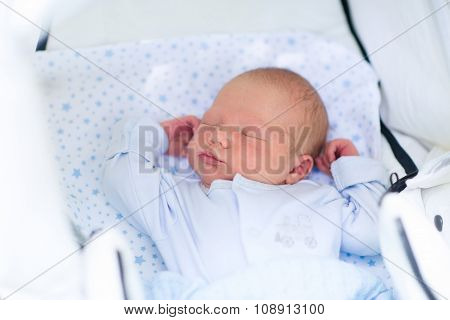 Sleeping Newborn Baby Boy In A Stroller
