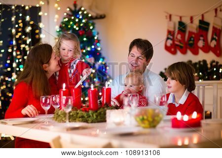 Family With Children At Christmas Dinner At Home