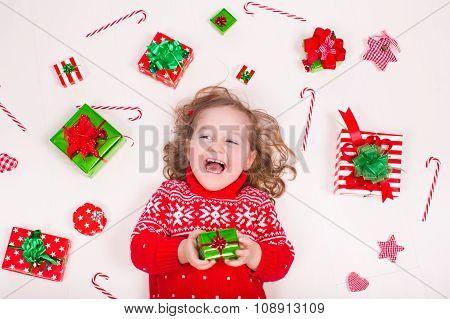 Little Girl Opening Christmas Presents