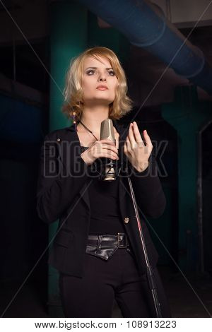 Rock Star Singing Into A Microphone