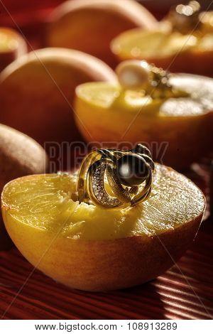 Earrings on sliced peaches