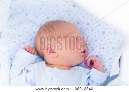 Sleeping Baby In A White Stroller