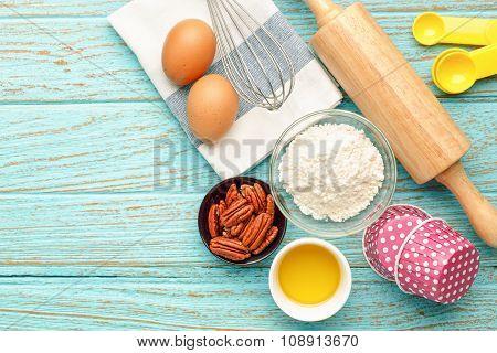 Baking Ingredients On Wood Background
