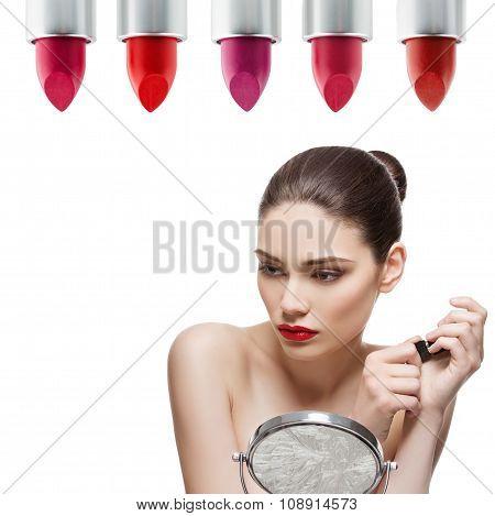 Beautiful girl holding lipstick